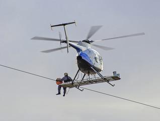 Repairing power gird from helicipter