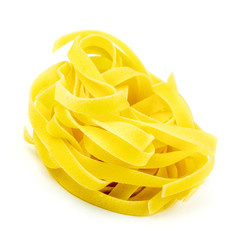 Uncooked Italian tagliatelle on a white background