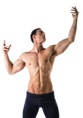 Handsome shirtless muscular young man in classic pose
