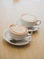 Two cups of cappuccino on the table