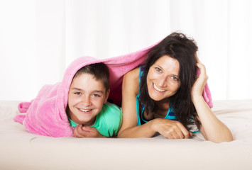 mother and son in bed