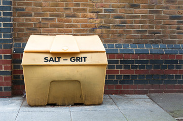Salt Grit bin against a brick wall
