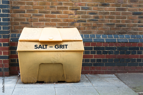 Salt Grit bin against a brick wall - 66837543