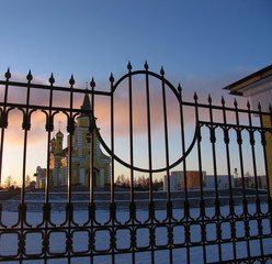 The Church through the lattice fence.