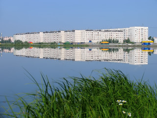 Nadym, Russia - July 20, 2004: panorama of the city on the river