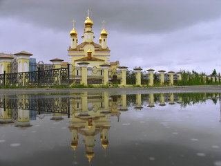 The Christian Church and its reflection in the water.