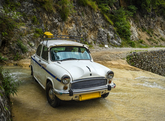 Old retro car parked on flat water flow