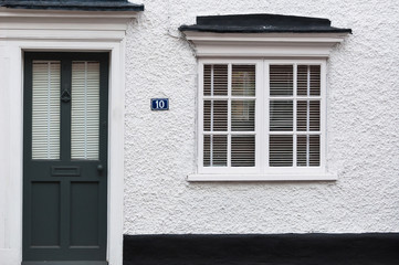 Close up of white rendered property number 10