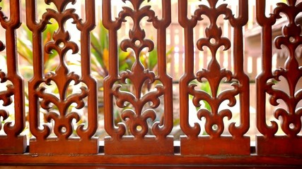 Beautiful wooden fence with ornaments. Macro video shift motion
