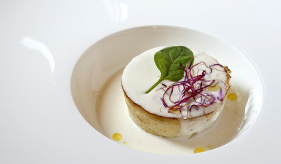 Leek flan served on Parmigiano Reggiano cheese fondue