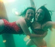 girls having fun underwater