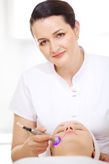 Cosmetician making lifting procedure