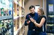 Couple choosing wine in a bottle store