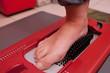 Leinwanddruck Bild - Foot during scanning on device