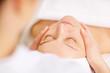Leinwanddruck Bild - Woman under professional facial massage in beauty spa