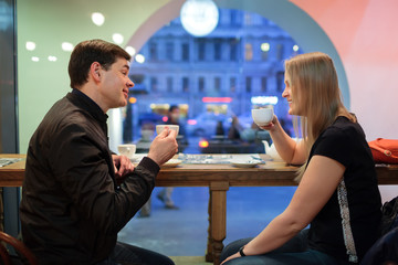 Man and woman chatting over coffee