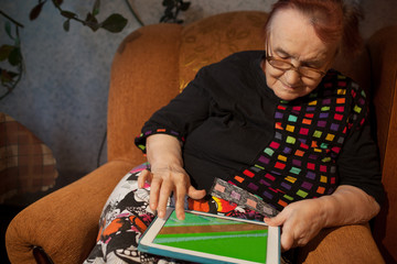 Senior woman surfing the internet on a tablet