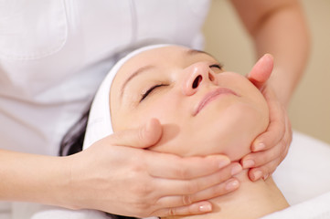 Facial massage at beauty treatment salon
