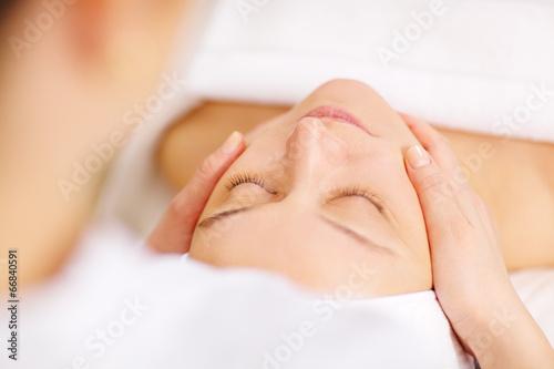 Leinwanddruck Bild Woman under professional facial massage in beauty spa