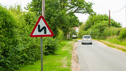 Road sign warning motorists of double bend