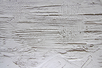 The white plastered relief wall