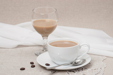 Cup Of Coffee and Irish Cream Liquor. Natural Linen Background