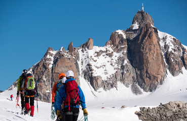 The Aiguille du Midi peak; in foreground a defocused group of mo