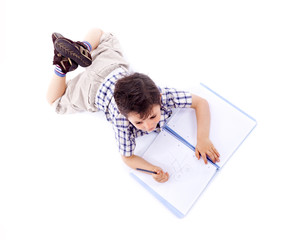 Above view of schoolboy drawing with pencil on notebook, isolate