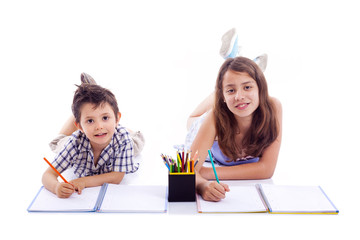 Two kids drawing with colored pencils, isolated on white bakgrou