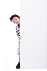 Little boy holding a white banner, isolated on white background