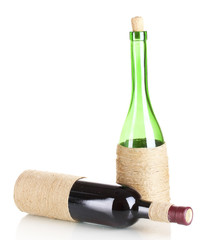 Decorative bottles of wine isolated on white