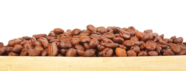 Coffee beans in bamboo bowl isolated on white