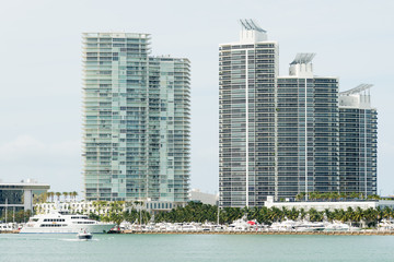 Modern residencial buildings on Miami Beach with yachts docked n
