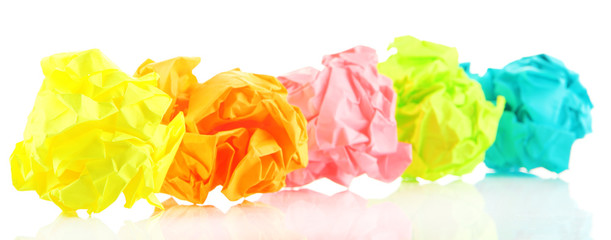 Colorful crumpled paper balls isolated on white