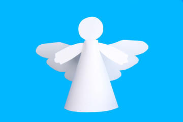 Christmas angel on light blue background