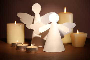 Christmas angels with candles on dark background