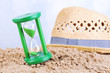 canvas print picture - Hourglass in sand on blue sky background