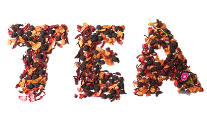 Tea mix with fruits and spices in a word shape, isolated