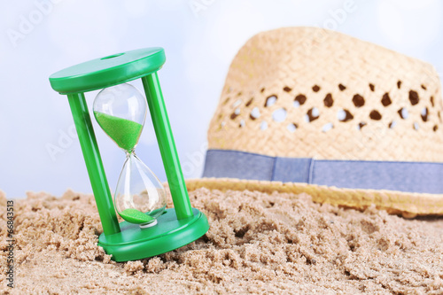 canvas print picture Hourglass in sand on blue sky background