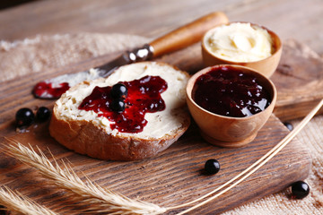 Fresh toast with homemade butter and blackcurrant jam