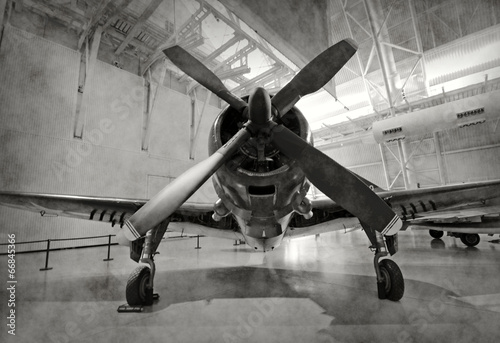 Old airplane in a hangar - 66845366