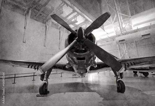 Deurstickers Vliegtuig Old airplane in a hangar