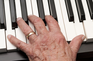 Old Hand on Piano Keys