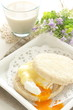 poached egg and cheese in English muffin Sandwish