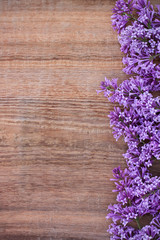 Lilac on an old wooden background