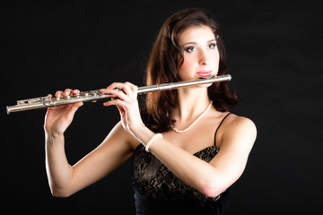 Art. Woman flutist flaustist musician playing flute