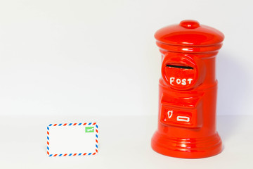Pillar-box with a airmail on a floor