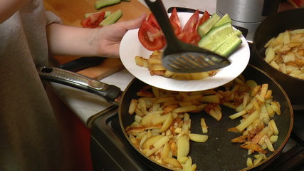 French Fries Put in Dish with Vegetables, closeup