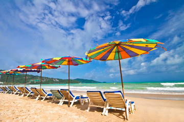 Beach chairs and colorful umbrella on the beach