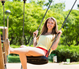 Woman on swing in summer